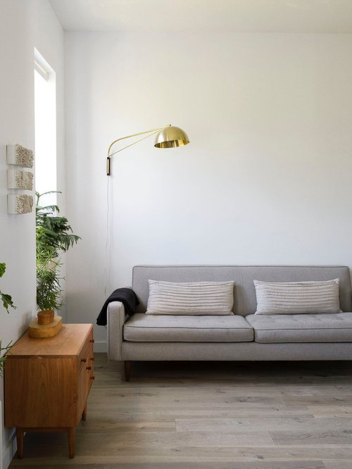 Midcentury Modern Formal And Enclosed Medium Tone Wood Floor Living Room  Idea In London With White