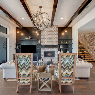 Living room - huge transitional open concept medium tone wood floor and brown floor living room idea in Boise with a ribbon fireplace, white walls, a brick fireplace and a tv stand