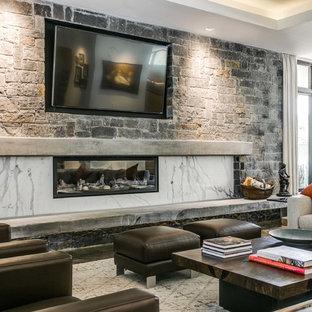ダラスの大きいミッドセンチュリースタイルのおしゃれなLDK (フォーマル、グレーの壁、コンクリートの床、横長型暖炉、石材の暖炉まわり、壁掛け型テレビ) の写真