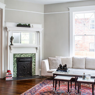 Classic enclosed living room in Atlanta with grey walls, dark hardwood flooring, a corner fireplace and brown floors.