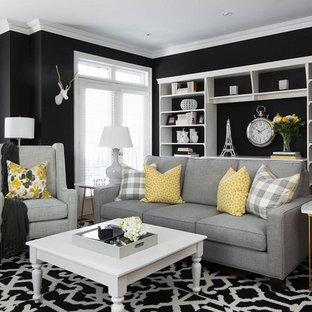 Foto di un soggiorno minimal di medie dimensioni e aperto con sala formale, pareti nere e parquet chiaro