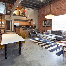 Industrial Living Room by Laura U, Inc.