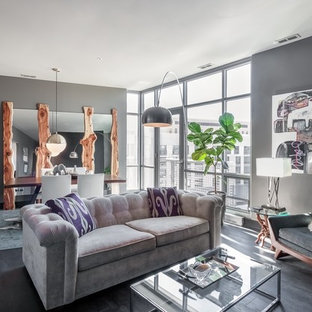 Example of a trendy open concept dark wood floor living room design in Omaha with gray walls and no tv
