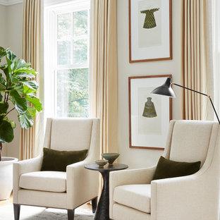 Imagen de salón para visitas cerrado, clásico renovado, de tamaño medio, sin televisor, con paredes grises, suelo de madera en tonos medios, chimenea tradicional y suelo marrón