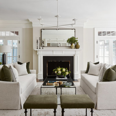 Inspiration for a mid-sized transitional enclosed and formal medium tone wood floor and brown floor living room remodel in Chicago with gray walls, a standard fireplace and no tv