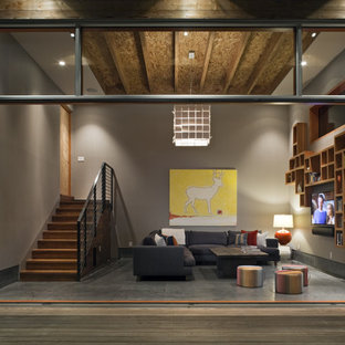 Photo of a large modern open plan living room in San Francisco with concrete flooring, brown walls, no fireplace and a wall mounted tv.