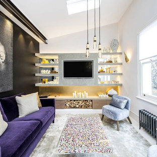 Photo of a medium sized contemporary mezzanine living room in London with white walls, a built-in media unit and white floors.