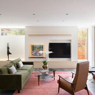 Trendy ceramic floor living room photo in Denver with white walls, a two-sided fireplace, a stone fireplace and a wall-mounted tv