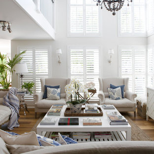 Design ideas for a beach style living room in Perth with white walls, light hardwood floors and no tv.