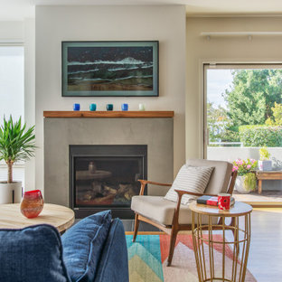 Example of a mid-sized trendy open concept and formal light wood floor and beige floor living room design in Seattle with white walls, a standard fireplace and a concrete fireplace