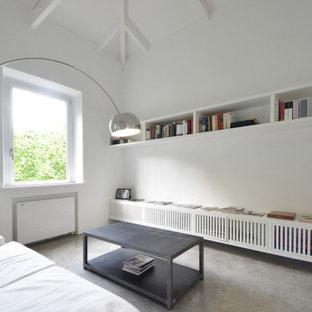 Imagen de salón actual, pequeño, con paredes blancas y moqueta