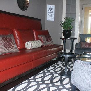Ispirazione per un soggiorno design di medie dimensioni e chiuso con pareti grigie e pavimento in ardesia
