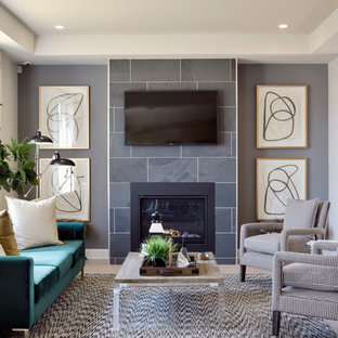 Inspiration for a contemporary living room in Ottawa with grey walls, a standard fireplace, a wall mounted tv and beige floors.