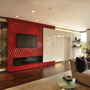 ロサンゼルスの広いアジアンスタイルのおしゃれなLDK (フォーマル、マルチカラーの壁、濃色無垢フローリング、横長型暖炉、タイルの暖炉まわり、壁掛け型テレビ) の写真