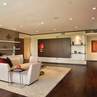 ロサンゼルスの大きいアジアンスタイルのおしゃれなLDK (フォーマル、ベージュの壁、濃色無垢フローリング、標準型暖炉、タイルの暖炉まわり、壁掛け型テレビ) の写真