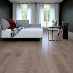 Mirage Hard Wood Flooring - Mirage Maple Graystone. Sculpted rock. Exhilarating warmth. This amazing combination of browns and gray stone create a very warm earthy floor with endless possibilities.