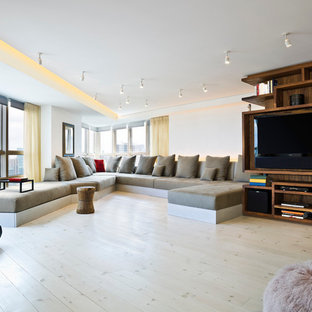 Living room - contemporary living room idea in New York with white walls and a media wall