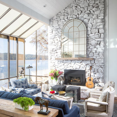 Example of a mid-sized beach style formal and open concept dark wood floor and brown floor living room design in Seattle with white walls, a standard fireplace, a stone fireplace and no tv