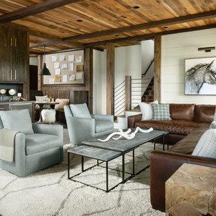 Rustikales Wohnzimmer ohne Kamin mit Hausbar, weißer Wandfarbe, Betonboden und grauem Boden in Denver