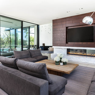 Inspiration for a contemporary beige floor living room remodel in Sacramento with white walls, a plaster fireplace and a wall-mounted tv