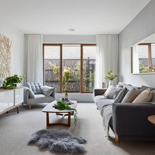 Photo of a scandinavian enclosed living room in Melbourne with grey walls, carpet and no tv.