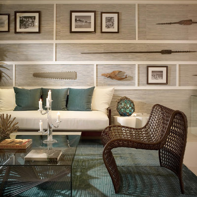 Living room - tropical living room idea in Miami with gray walls