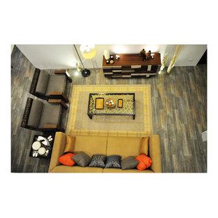 Foto di un grande soggiorno etnico aperto con pareti bianche, pavimento in gres porcellanato, nessun camino e nessuna TV