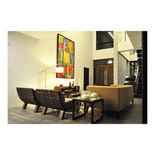 Immagine di un grande soggiorno etnico aperto con pareti bianche, pavimento in gres porcellanato e nessun camino