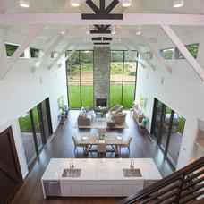 Farmhouse Living Room by Plum Builders, Inc.