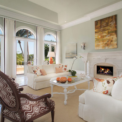 Large trendy formal and open concept ceramic tile and beige floor living room photo in Miami with gray walls, a standard fireplace, a stone fireplace and no tv