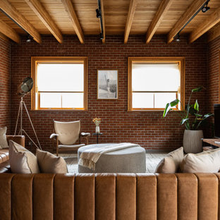 Inspiration for an industrial open concept concrete floor, gray floor, exposed beam, wood ceiling and brick wall living room remodel in New York with red walls and a tv stand