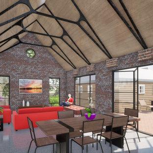 Imagen de salón abierto, abovedado y ladrillo, minimalista, de tamaño medio, ladrillo, con paredes rojas, suelo de cemento, suelo gris y ladrillo