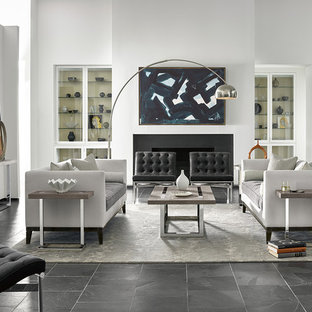 Example Of A Minimalist Formal And Open Concept Slate Floor Black Living Room Design