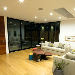 Inspiration for a mid-sized contemporary formal enclosed living room in Los Angeles with white walls, light hardwood floors, no fireplace and no tv.