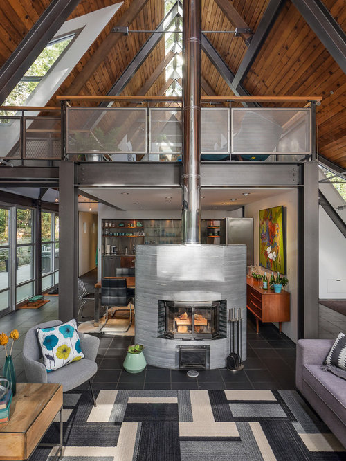 Medium Sized Industrial Mezzanine Living Room In Seattle With White Walls Slate Flooring A