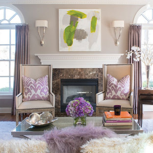 Inspiration for a timeless medium tone wood floor living room remodel in New York with gray walls, a standard fireplace and no tv