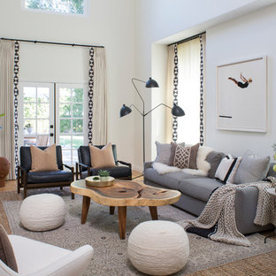 Example of a transitional formal light wood floor living room design in Los Angeles with white walls, a standard fireplace and a brick fireplace