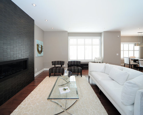 Trendy Dark Wood Floor Living Room Photo In Calgary With Beige Walls, A  Ribbon Fireplace Part 76