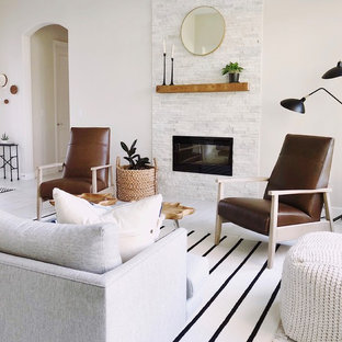 Design ideas for a scandinavian living room in Orlando with beige walls, a ribbon fireplace, a stone fireplace surround and beige floors.