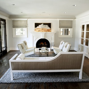 Mid-sized minimalist formal and enclosed medium tone wood floor living room photo in Seattle with white walls, a standard fireplace, a wood fireplace surround and no tv