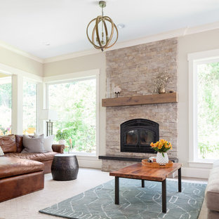 Inspiration for a mid-sized rustic open concept medium tone wood floor and brown floor living room remodel in Seattle with gray walls, a standard fireplace, a stone fireplace and no tv