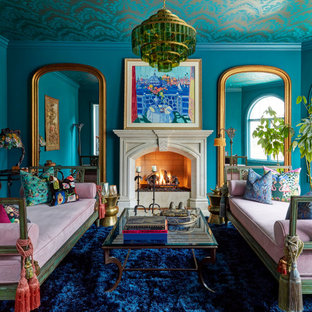 This is an example of a large victorian formal enclosed living room in Chicago with blue walls, a standard fireplace and no tv.