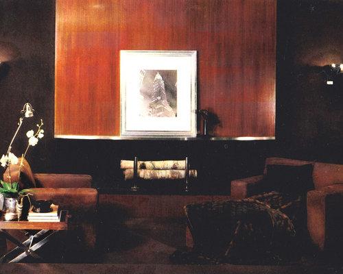 Salon avec une bibliothèque ou un coin lecture classique avec ...