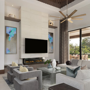 Example Of A Large Minimalist Open Concept Porcelain Floor And Beige Living Room Design In