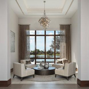 Foto di un soggiorno moderno di medie dimensioni con sala formale, pareti bianche, pavimento in gres porcellanato, nessun camino, nessuna TV e pavimento beige