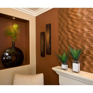 Inspiration for a contemporary living room in Orange County with brown walls.