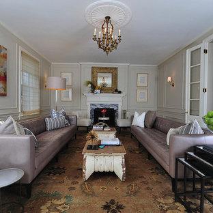 Esempio di un grande soggiorno minimalista chiuso con pareti beige, camino classico, nessuna TV, sala formale, pavimento in legno massello medio e cornice del camino in pietra
