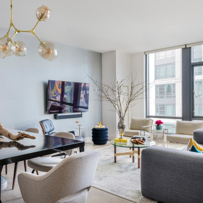 Inspiration for a small contemporary open concept light wood floor and beige floor living room remodel in Boston with gray walls and a wall-mounted tv
