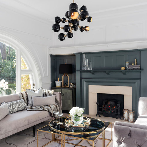 Traditional Formal Living Room In Dorset With Blue Walls, A Standard  Fireplace And No Tv