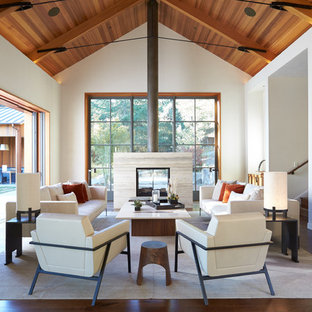 Example of a large cottage open concept and formal dark wood floor living room design in San Francisco with white walls, a two-sided fireplace and a tile fireplace